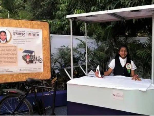Vinisha_Picture_with_solar_iron_cart_UpdateNews360